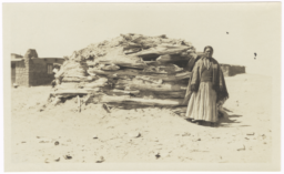 Navajo Woman Standing in front of a Hogan, Farmington, New Mexico