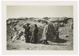 Two Women and a Man Standing near a Rocky Outcropping