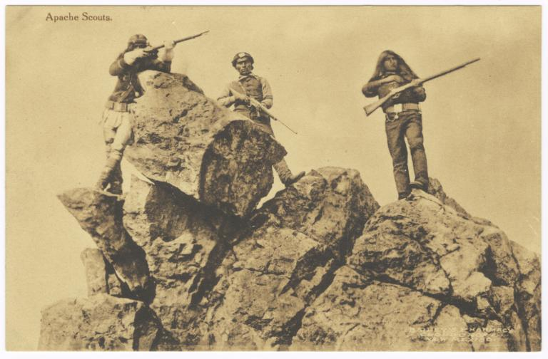 Apache Scouts with Guns Posed by Rock Outcropping