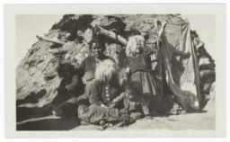 American Indian Women and Children in front of a Hogan