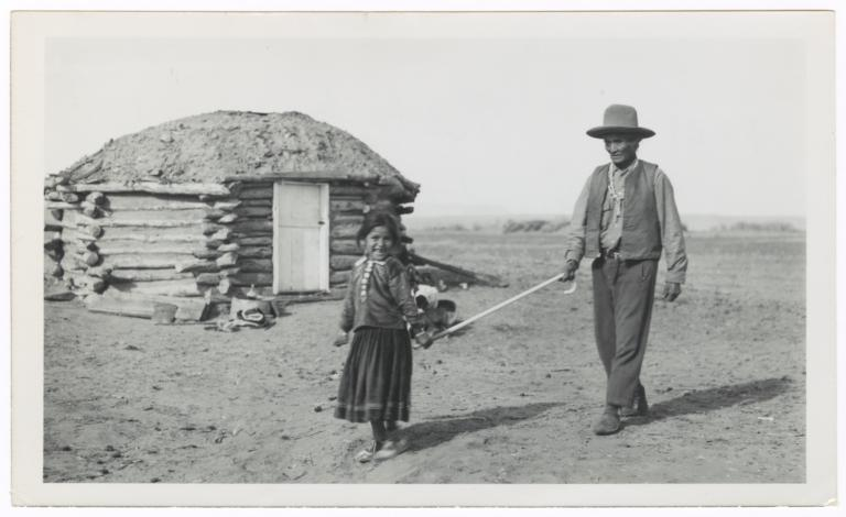 Young Navajo Girl Guiding a Blind Man, Chinle, Arizona