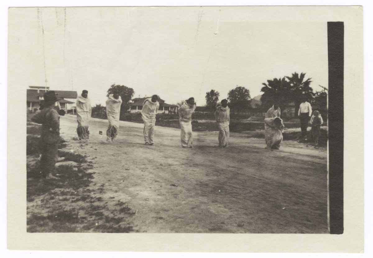 American Indian Men Competing in a Sack Race