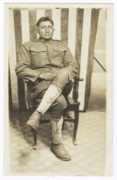 Sam Sevaskeoyame, a Walapai Indian, in Uniform, Posed in front of an American Flag