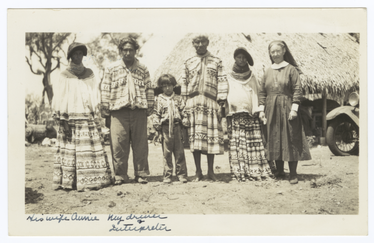 Deaconess Bedell Posing with Seminole Indians, Everglades, Florida