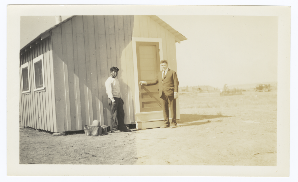 Sherman and Floyd O. Burnett in front of a Cabin, Modoc County, California