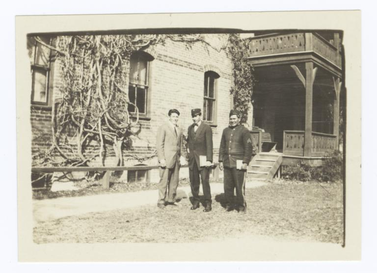 Three Men Standing in front of Side Porch