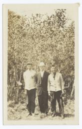 Three Men Posing for the Camera