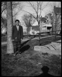Young Man Standing on the Grounds of Haskell Institute, Lawrence, Kansas