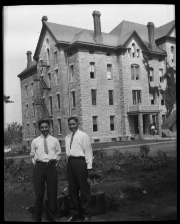 Two Men in front of Building