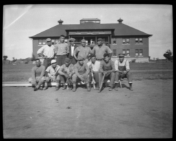 Sports Team Posing in Two Rows on the Field
