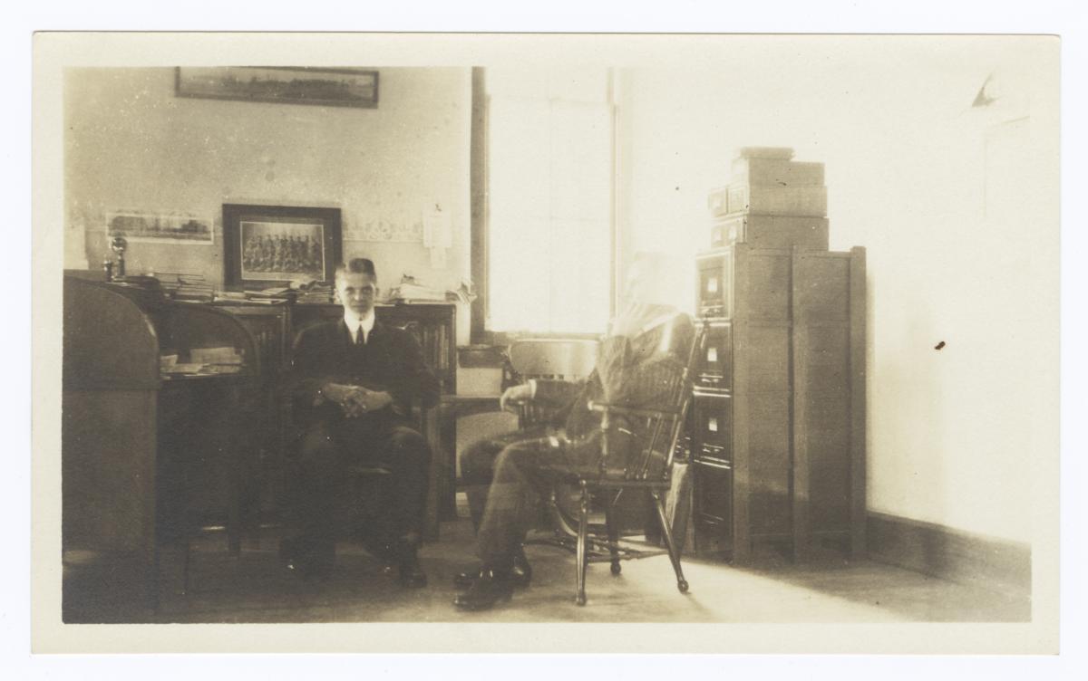 Two Men Sitting in an Office