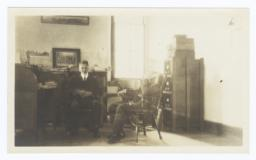 Two Men Sitting in an Office