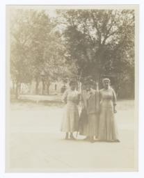 Three Women Posing for the Camera