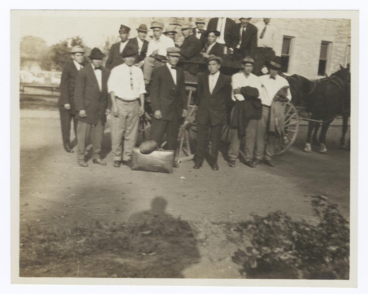 Men Waiting to Travel, Standing around or in a Horse and Wagon