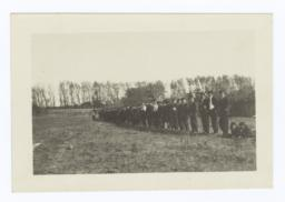 Line of Students in Uniform Standing along the Edge of the Field