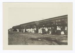 Group of Spectators Returning to the Train