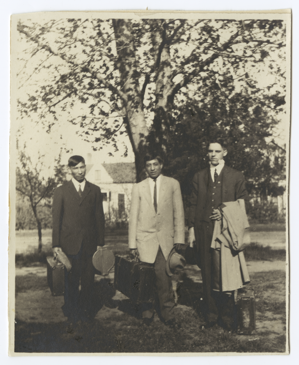 Three Men in Suits Ready for Travel