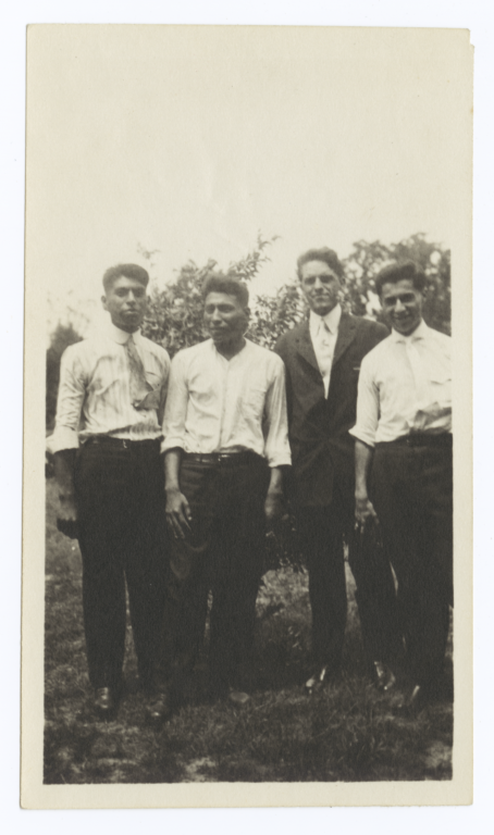Four Men Posing for the Camera