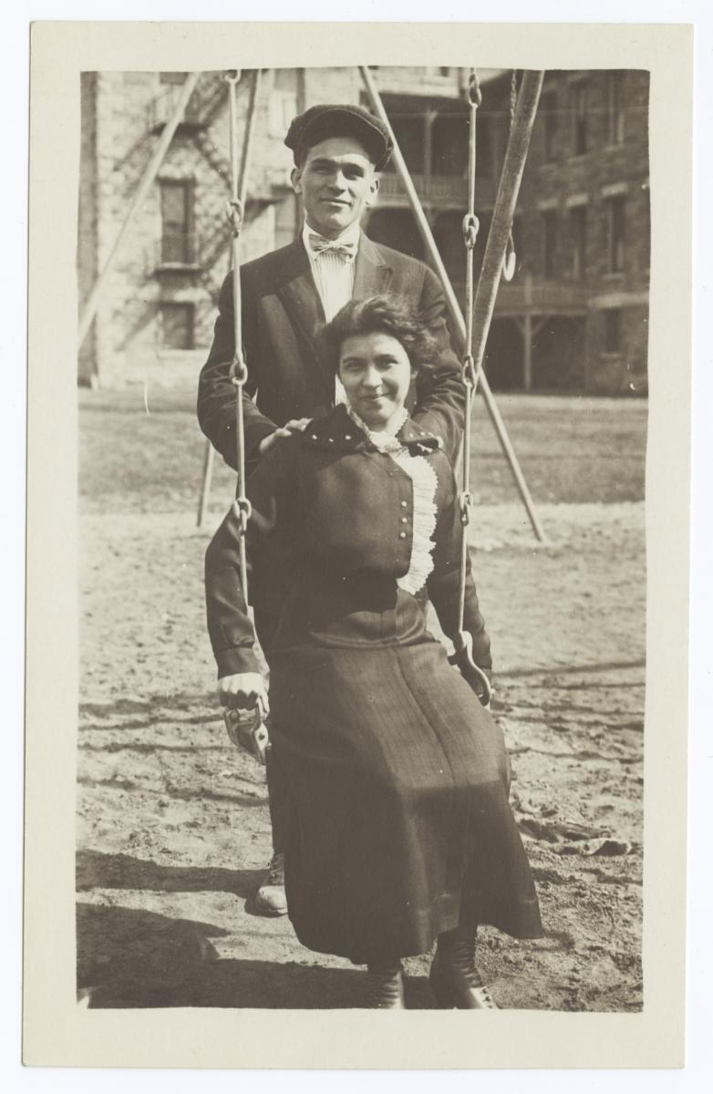 Young Couple Posed with Lady Sitting on a Swing