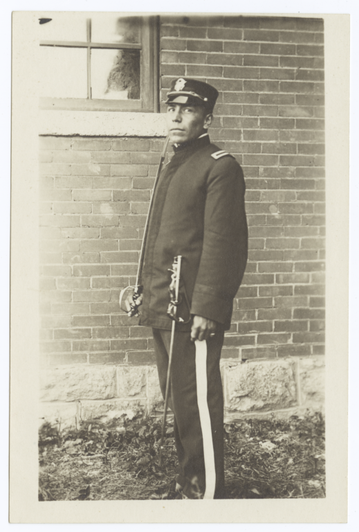 Young Man in Uniform Holding a Sword
