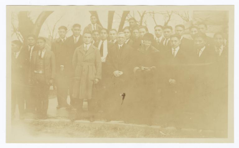 Group of Men and Women Gathered around Trees