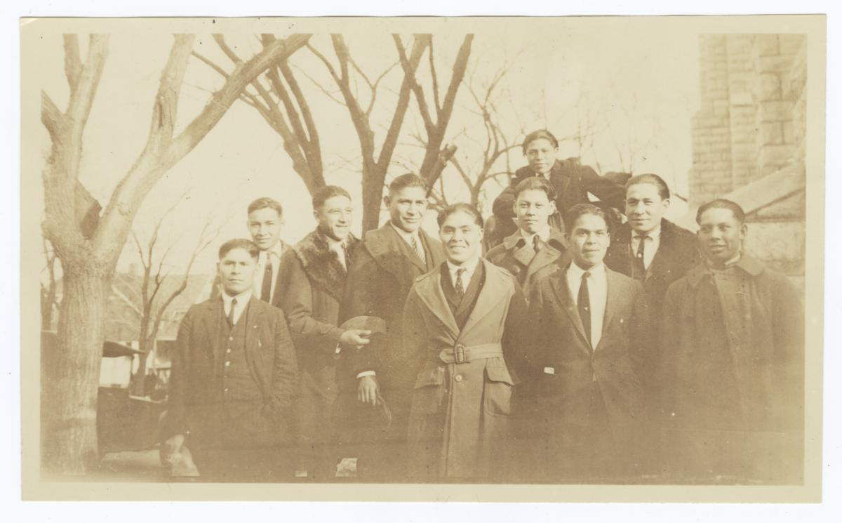 Group of Young Men Gathered under Trees
