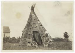 Reverend and Mrs. John Silas in Front of Birch Bark Tipi, near Mikado, Michigan