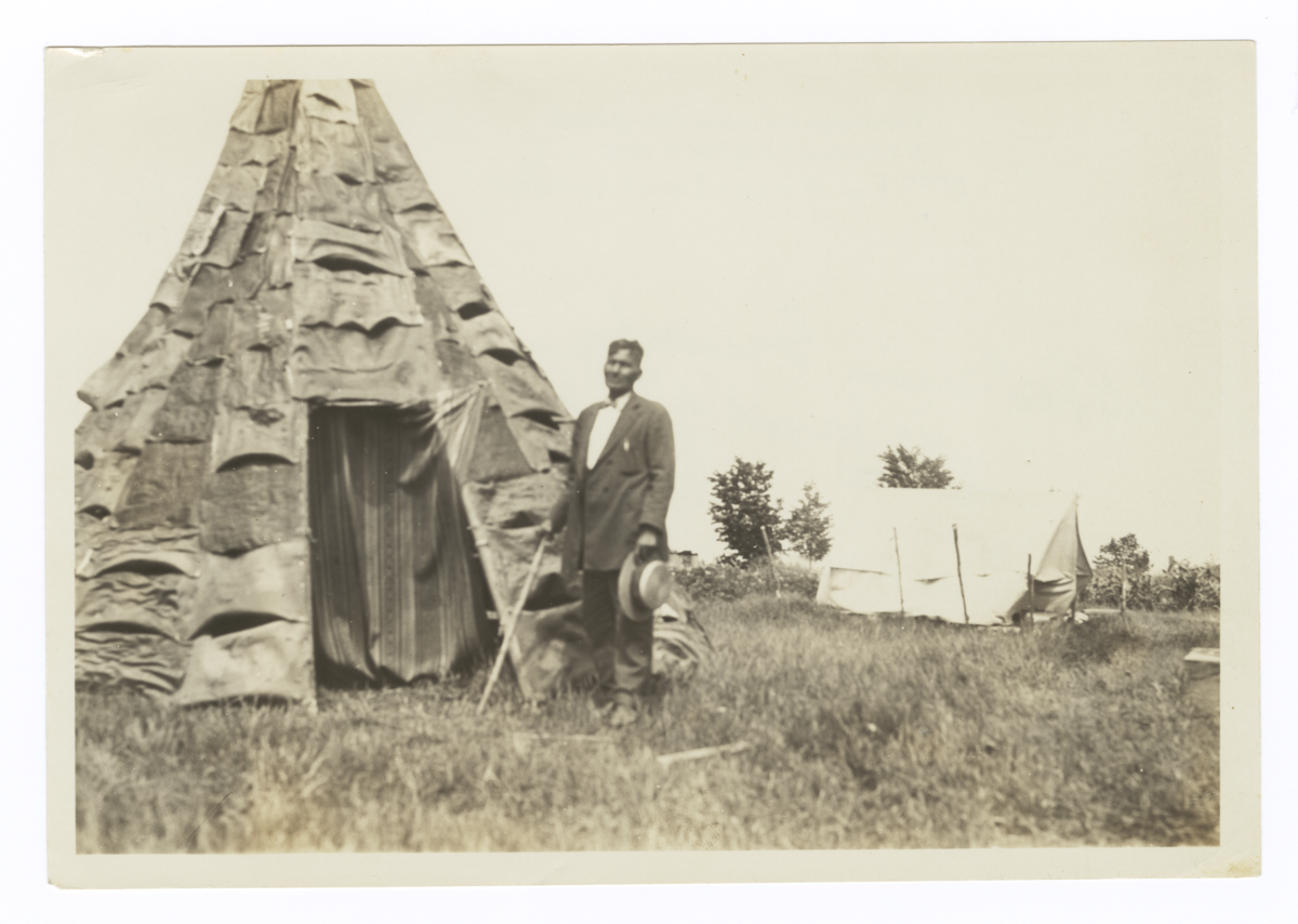 Reverend Simon Greensky in front of a Birch Bark Teepee at His Home near Mikado, Michigan