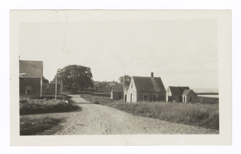 View Down a Dirt Road with Wood Buildings, Maine