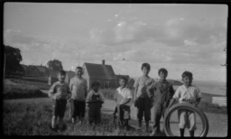 Group of Children Posing in front of a Village