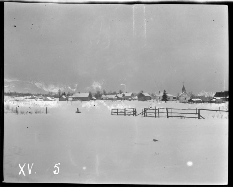 View of Nett Lake Village, Minnesota in the Winter, with a Roman Catholic Church to the Right