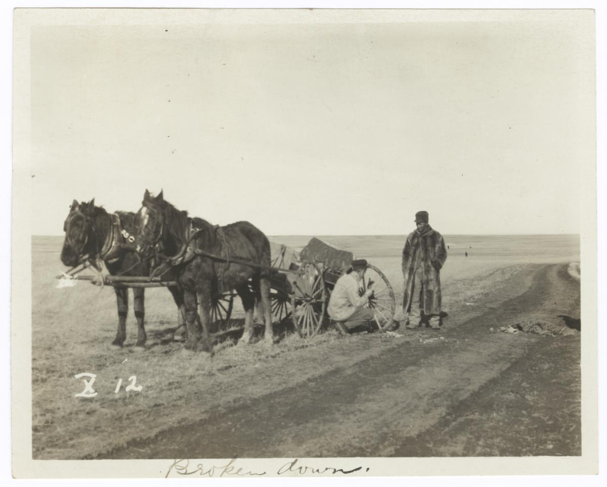 Two Men Repairing a Broken Carriage Wheel, Minnesota
