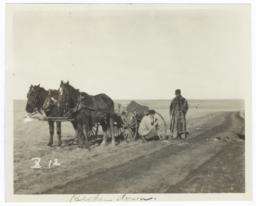 Two Men Repairing a Broken Carriage Wheel, Minnesota