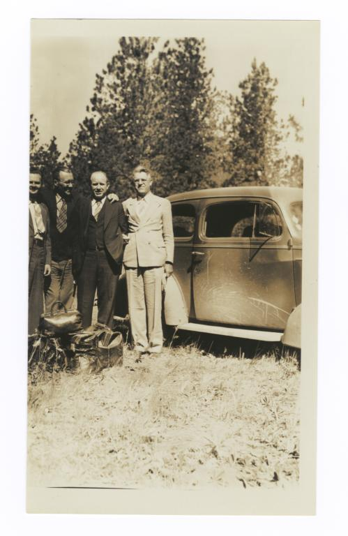 G.E.E. Lindquist and Three Other Men Next to a Car