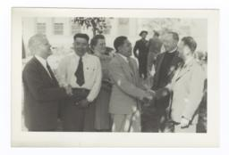 G.E.E. Lindquist Shaking Hands with Percy Tibbets