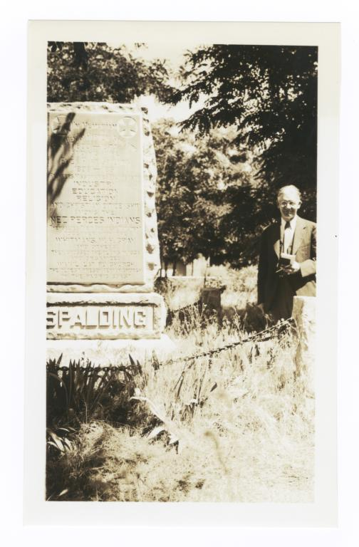 Reverend G.A. Watermulder beside Grave of Reverend Henry Harmon Spalding, Spalding, Idaho