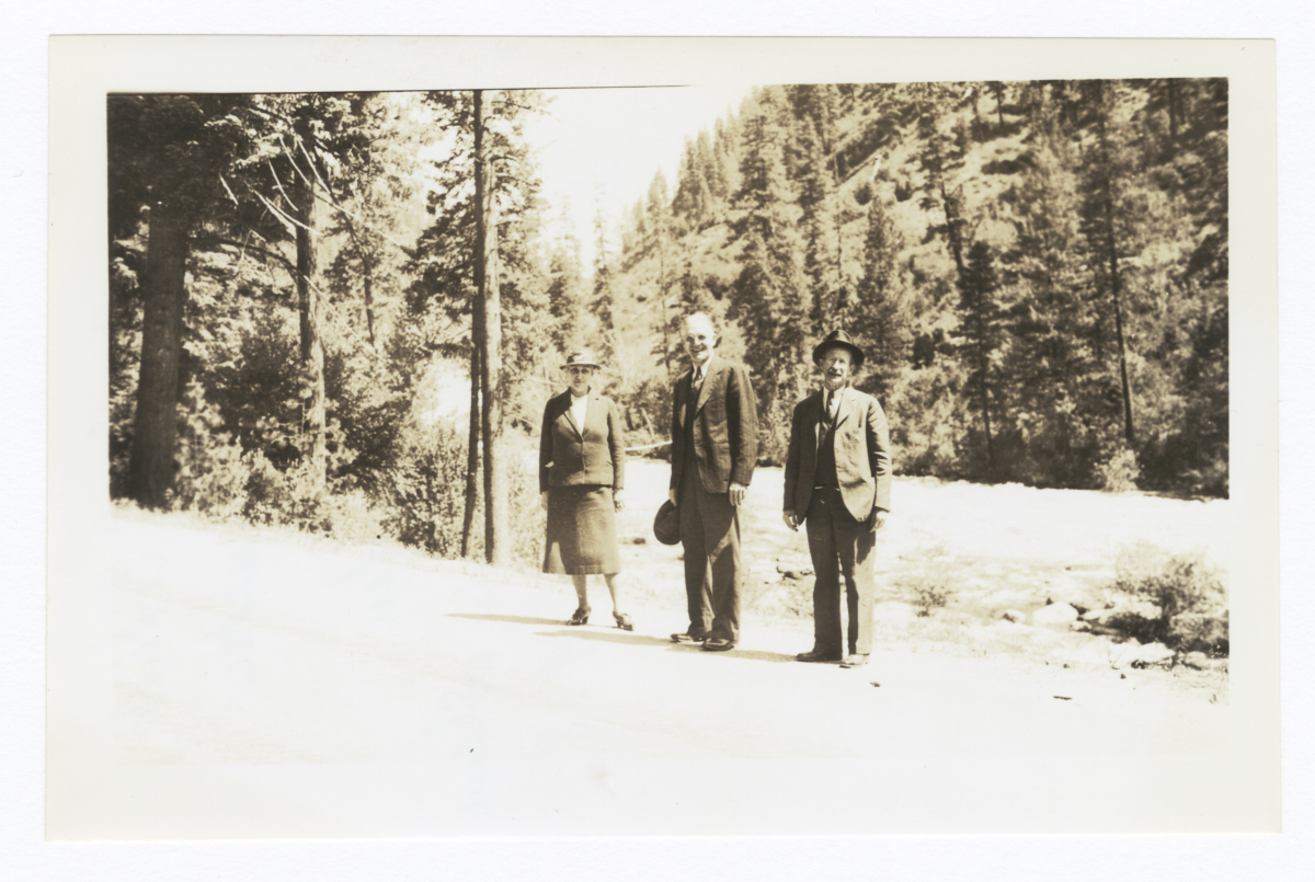 Miss Bertha M. Eckert, Reverend G.A. Watermulder, and Mr. M.K. Sniffen beside Idaho Mountain Stream