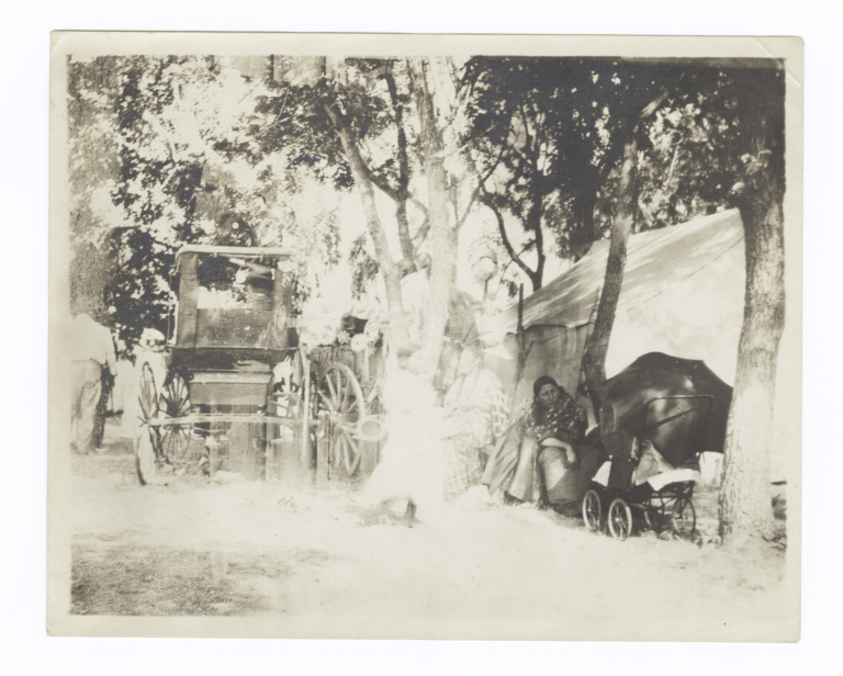 Three American Indian Women and a Girl near Carriage, Tent