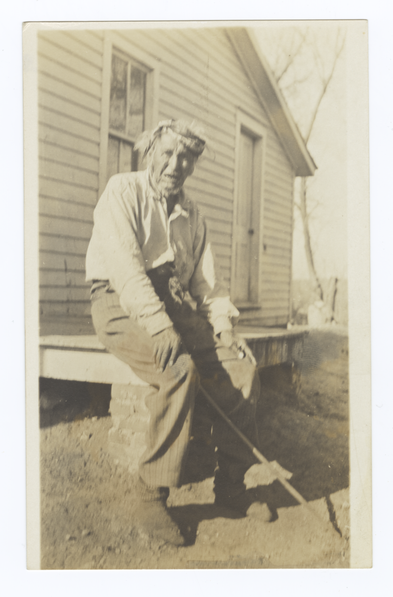 Elder American Indian Man on Stoop of House