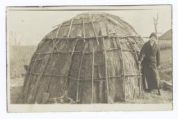 Woman next to a Wickiup