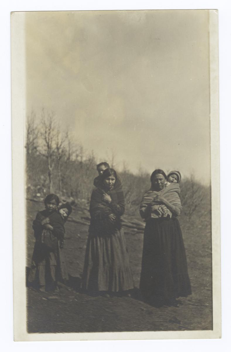 Two American Indian Women, a Girl and Three Babies