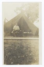 Young American Indian Man in front of Tent