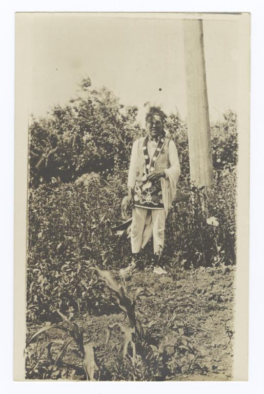 American Indian Man in Traditional Dress in Field