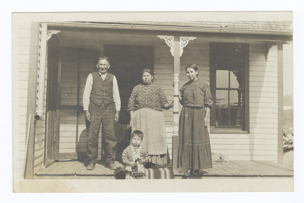 American Indian Couple with Young Woman and Baby in front of House, Nebraska