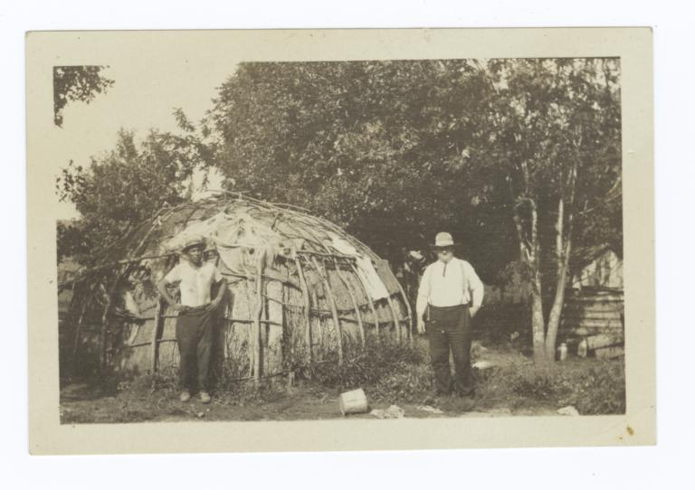 Two Men in Front of Wickiup