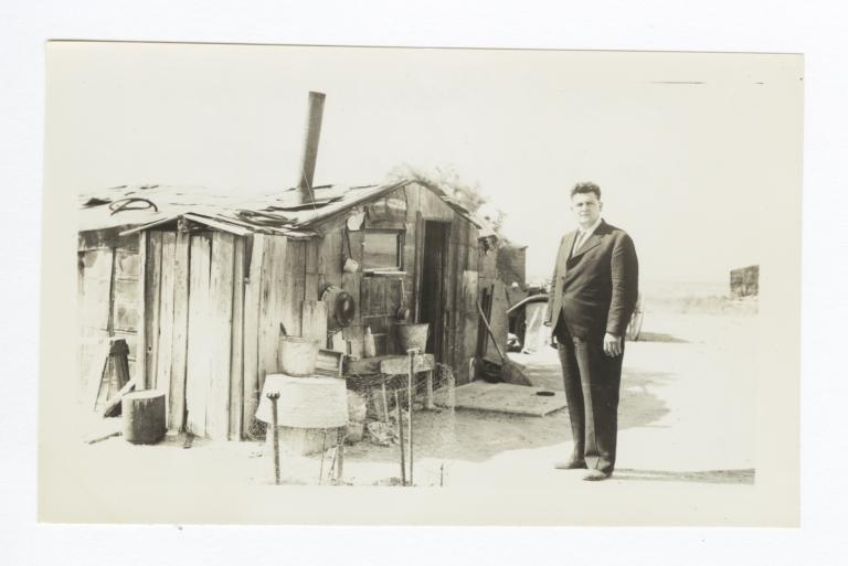 Reverend Floyd O. Burnett in front of Indian Home
