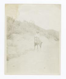 Dennis Fredo Riding a Horse