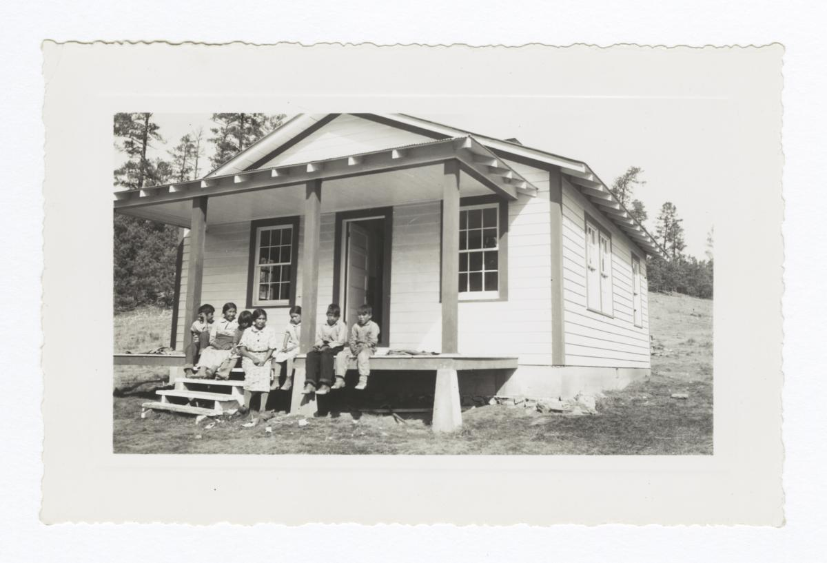 Mescalero Adults and Children Sitting on Porch of House, Mescalero, New Mexico