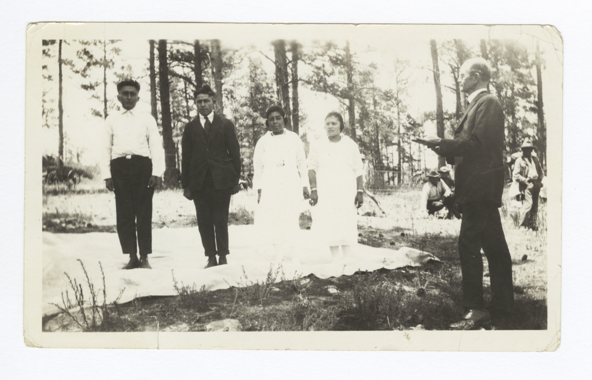 Outdoor Wedding of Two Mescalero Couples, Overman (Missionary) Officiating