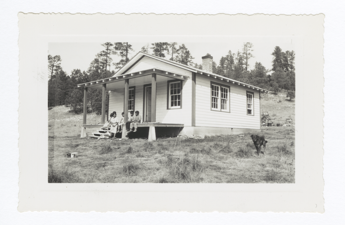 Mescalero Family and Their Dog in front of House